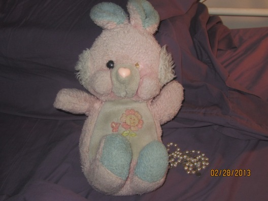 Caroline the Rabbit and rosary (Yes Caroline is missing an eye. She's had a rough life.)