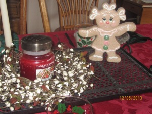 Christmas table centerpiece--I made the gingerbread girl in ceramics class a million years ago.