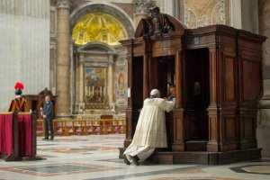 Pope Francis going to confession.