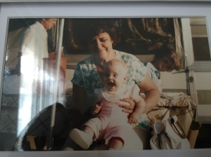 me on my grandmother's lap, with my grandfather and one of my aunts behind.